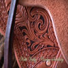 Light weight Lady's Wade Saddle with horse figure and floral tooling with hand painted dyed background all dallied in a Vaquero Lace border