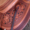 Half tooled Vaquero Lace with Daffodil flower Wade Saddle       built on a 94 degree bar that fits a well built muscular shoulders - The seat is finished at 15 & 1/2 inch with a close contact deep pocket fit - Gullet is 7 & 1/2 inch height by 6 & 1/2 width with the back hand hole width at 4 inch - Horn is 6 inch height by 5 and 1/2 inch width Guadalajara at 31 degree pitch - Cantle is 4 and 1/2 inch in height by 12 & 1/2 in width with a Cheyenne roll - Flat plate riggin at 7/8ths - leather lined 5 inch Stainless Steel Moran Stirrups .