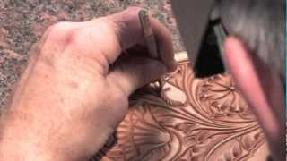 The veiner in hand tooled saddle art